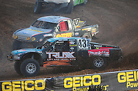 Dec. 11, 2011; Chandler, AZ, USA;  LOORRS pro 4 driver Curt LeDuc leads Greg Adler during the Lucas Oil Challenge Cup at Firebird International Raceway. Mandatory Credit: Mark J. Rebilas-
