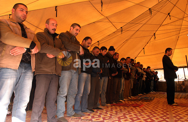 Palestinians attend Friday prayers at the protest tent in the Silwan neighborhood in East Jerusalem on Dec. 9,2011 as Palestinian protesters gather for a demonstration. Photo by Mahfouz Abu Turk