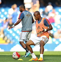 Andre Ayew of Swansea warms up  during the Barclays Premier League match between  Chelsea and Swansea  played at Stamford Bridge, London