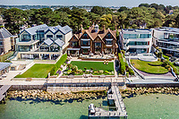 BNPS.co.uk (01202) 558833. <br /> Pic: TailorMade/BNPS<br /> <br /> Pictured: Harbour Gate. <br /> <br /> A multi-millionaire is hoping to have a shot at selling his luxury mansion - by throwing a hi-tech golf simulator into the deal.<br />  <br /> Golf-loving Barry Bester put the waterfront property on Sandbanks, Dorset, on the market for £11m last year.<br />  <br /> He is now offering his £40,000 state-of-the-art simulator he has had built on the grounds with the sale.