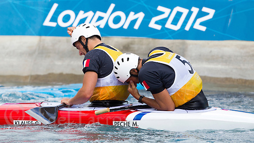 02 AUG 2012 - CHESHUNT, GBR - Gauthier Klauss (FRA) (left) and Matthieu Peche (FRA) (right) of France recover after making their final run in the men's Canoe Double (C2) during the London 2012 Olympic Games final at Lee Valley White Water Centre, Cheshunt, Great Britain .(PHOTO (C) 2012 NIGEL FARROW)