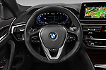 Car pictures of steering wheel view of a 2021 BMW 5-Series 530i-Sport 4 Door Sedan Steering Wheel