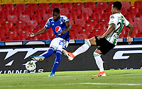 BOGOTA - COLOMBIA, 31-10-2020: Emerson Rodriguez de Millonarios F. C. y Sebastian Gomez de Atletico Nacional disputan el balon, durante partido entre Millonarios F. C. y Atletico Nacional de la fecha 17 por la Liga BetPlay DIMAYOR 2020 jugado en el estadio Nemesio Camacho El Campin de la ciudad de Bogota. / Emerson Rodriguez of Millonarios F. C. and Sebastian Gomez of Atletico Nacional figth for the ball, during a match between Millonarios F. C. and Atletico Nacional of the 17th date for the BetPlay DIMAYOR League 2020 played at the Nemesio Camacho El Campin Stadium in Bogota city. / Photo: VizzorImage / Luis Ramirez / Staff.