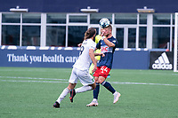 FOXBOROUGH, MA - JULY 4: Pierre Cacet #44 of the New England Revolution II heads a high ball near the New England Revolution II II goal during a game between Greenville Triumph SC and New England Revolution II at Gillette Stadium on July 4, 2021 in Foxborough, Massachusetts.