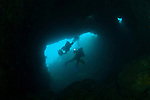 The Cavern is open to the reef top and sunlight streams down into the entrance.  This image was taken prior to the MV Rena wrecking on Astrolabe Reef in 2011. It is understood that the weight of the Rena has damaged this geological feature and popular dive site.