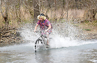 BIG SPLASH ATTACK<br />Logan Chambers of Farmington sports a flowery dress and wig while hitting the chilly water of Lee Creek on Saturday April 3 2021 during the Big Splash Contest at the 32nd annual Ozark Mountain Bike Festival at Devil's Den State Park. Contestants got extra points for spashing down in costume in the contest to see who could make the biggest splash. The festival also featured guided group mountain bike rides for beginner and experienced riders, instructional rides to improve riding technique, bike limbo and a skills course for kids. Riders were alsopermitted to pedal over some of the new trails in the park that will not officially open for about a month. Go to nwaonline.com/210404Daily/ to see more photos.<br />(NWA Democrat-Gazette/Flip Putthoff)