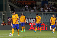 Calcio: amichevole Fiorentina vs Barcellona. Firenze, stadio Artemio Franchi, 2 agosto 2015.<br /> FC Barcelona's Luis Suarez, left, and his teammates react after Fiorentina scored for the second time during the friendly match between Fiorentina and FC Barcelona at Florence's Artemio Franchi stadium, 2 August 2015.<br /> UPDATE IMAGES PRESS/Riccardo De Luca