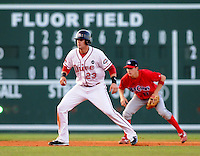 July 29, 2009: Casey Kelly (23) of the Greenville Drive, a top Boston Red Sox pitching prospect now playing shortstop, takes a lead off second base in a game at Fluor Field at the West End in Greenville, S.C. Defending is Lakewood BlueClaws shortstop Korby Mintken (11). Photo by: Tom Priddy/Four Seam Images