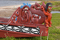 Decorative Detail on Stern of Maori Canoe, Ohinemutu Maori Village, Rotorua, north island, New Zealand.  St. Faith Church in Background.
