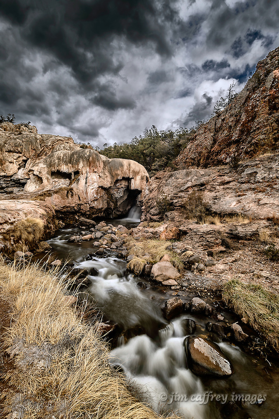 Soda Dam, just north of Jemez Springs, New Mexico, is a large calcium carbonate formation deposited by small geothermal springs.