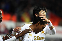 Saturday 19 January 2013<br /> Pictured: Jonathan de Guzman (FRONT) of Swansea celebrating his second goal with team mate Ki Sung Yueng.<br /> Re: Barclay's Premier League, Swansea City FC v Stoke City at the Liberty Stadium, south Wales.