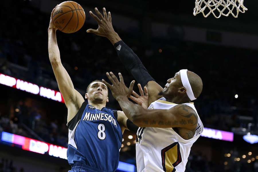 Minnesota Timberwolves guard Zach LaVine (8) shoots against New Orleans Pelicans forward Dante Cunningham (44) during the second half of an NBA basketball game Saturday, Feb. 27, 2016, in New Orleans. The Timberwolves won 112-110. (AP Photo/Jonathan Bachman)