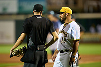 Bradenton Marauders manager Jonathan Johnston (19) questions a call with umpire Kenny Jackson during Game Two of the Low-A Southeast Championship Series against the Tampa Tarpons on September 22, 2021 at LECOM Park in Bradenton, Florida.  (Mike Janes/Four Seam Images)