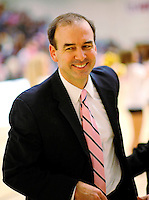 13 February 2011: University of Vermont Catamount basketball Head Coach Mike Lonergan is all smiles after a game against the Binghamton University Bearcats at Patrick Gymnasium in Burlington, Vermont. The Catamounts came from behind to defeat the Bearcats 60-51 in their America East matchup. The Cats took part in the National Pink Zone Breast Cancer Awareness Program by wearing special white jerseys with pink trim. The jerseys were auctioned off following the game with proceeds going to the Vermont Cancer Center. Mandatory Credit: Ed Wolfstein Photo