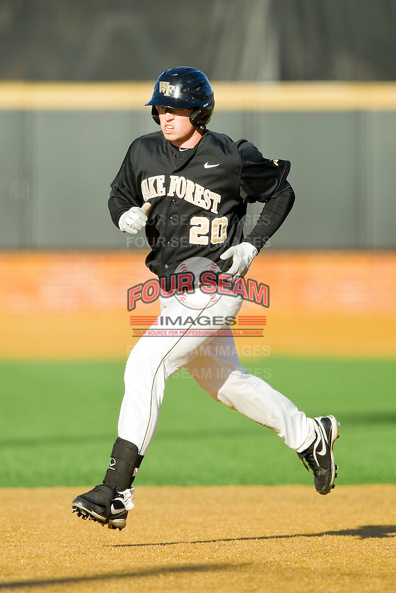 Jack Carey (20) of the Wake Forest Demon Deacons rounds the bases after hitting a home run against the West Virginia Mountaineers at Wake Forest Baseball Park on February 24, 2013 in Winston-Salem, North Carolina.  The Demon Deacons defeated the Mountaineers 11-3.  (Brian Westerholt/Four Seam Images)