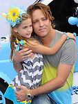 Larry Birkhead and Dannielynn Marshall at The Columbia Pictures and Sony Pictures Animation L.A. Premiere of The Smurfs 2 held at The Regency Village Theatre in Westwood, California on July 28,2013                                                                   Copyright 2013 Hollywood Press Agency