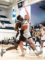 WASHINGTON, DC - JANUARY 5: Jamison Battle #10 of George Washington blocks Justin Winston #35 of St. Bonaventure during a game between St. Bonaventure University and George Washington University at Charles E Smith Center on January 5, 2020 in Washington, DC.
