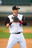 Arkansas Travelers shortstop Eric Stamets (8) warms up before a game against the Corpus Christi Hooks on May 29, 2015 at Dickey-Stephens Park in Little Rock, Arkansas.  Corpus Christi defeated Arkansas 4-0 in a rain shortened game.  (Mike Janes/Four Seam Images)
