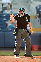 Home plate umpire James Pattison makes a call during a game between the Palm Beach Cardinals and Charlotte Stone Crabs on April 12, 2014 at Charlotte Sports Park in Port Charlotte, Florida.  Palm Beach defeated Charlotte 6-2.  (Mike Janes/Four Seam Images)