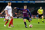 Philippe Coutinho of FC Barcelona (R) attempts a kick while being defended by Daniel Carrico of Sevilla FC (L) during the La Liga 2018-19 match between FC Barcelona and Sevilla FC at Camp Nou Stadium on October 20 2018 in Barcelona, Spain. Photo by Vicens Gimenez / Power Sport Images