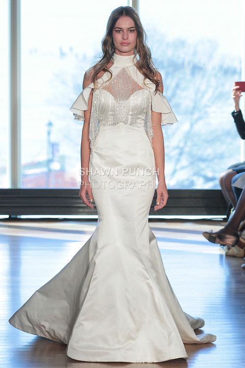 """Model Karen walks runway in a """"Donna"""" bridal gown from the Rivini Spring Summer 2017 bridal collection by Rita Vinieris at The Standard Highline Room, during New York Bridal Fashion Week on April 15, 2016."""
