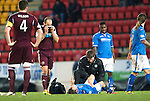 St Johnstone v Hearts.....18.01.14   SPFL<br /> Jamie Hamill hides his face as he looka at Murray Davidson's damaged left knee as he is treated by physio Fearghal Kerin. Davidson was stretchered off and taken to hospital for an operation<br /> Picture by Graeme Hart.<br /> Copyright Perthshire Picture Agency<br /> Tel: 01738 623350  Mobile: 07990 594431