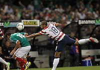 MEXICO CITY, MEXICO - AUGUST 15, 2012:  Terrence Boyd (18) of the USA MNT heads over Hector Moreno (15) of  Mexico during an international friendly match at Azteca Stadium, in Mexico City, Mexico on August 15. USA won 1-0.