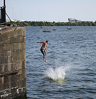 Saturday July 26th 2014 <br /> Pictured: Cardiff Bay <br /> RE: Men jump into the water at Cardiff Bay during the heat wave