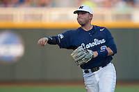 North Carolina second baseman Mike Zolk (3) makes a throw to first base during Game 10 of the 2013 Men's College World Series against the North Carolina State Wolfpack on June 20, 2013 at TD Ameritrade Park in Omaha, Nebraska. The Tar Heels defeated the Wolfpack 7-0, eliminating North Carolina State from the tournament. (Andrew Woolley/Four Seam Images)