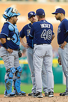 Tampa Bay Rays pitching coach Jim Hickey (48) has a meeting on the mound with his starting pitcher, Matt Moore (55), as well as catcher Jose Molina (28) and first baseman James Loney (21) during the Major League Baseball game Detroit Tigers at Comerica Park on June 4, 2013 in Detroit, Michigan.  The Tigers defeated the Rays 10-1.  Brian Westerholt/Four Seam Images