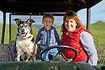 Mother and son drive the ranch four wheeler, San Luis Obispo, California