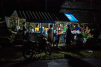 Bali, Indonesia.  Pre-dawn Shopping, Buying Food Ingredients for the Day.  Babakan Village.