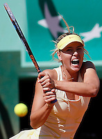 Maria Sharapova of Russia returns the ball against Andrea Petkovic of Germany in the quarter final match of the French Open tennis tournament in Roland Garros stadium in Paris, Wednesday June 1, 2011. Sharapova won in two sets 6-0, 6-3. (foto: Srdjan Stevanovic/Starsportphoto ©)