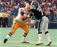 Vince Goldsmith Toronto Argonauts and Hector Pothier Edmonton Eskimos 1984 Photo Scott Grant
