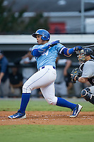Xavier Fernandez (34) of the Burlington Royals follows through on his swing against the Pulaski Yankees at Burlington Athletic Park on August 6, 2015 in Burlington, North Carolina.  The Royals defeated the Yankees 1-0. (Brian Westerholt/Four Seam Images)