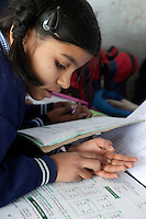 Madrasa Student doing Mathematics Calculation on her Fingers, Madrasa Islamia Arabia Izharul-Uloom, Dehradun, India.