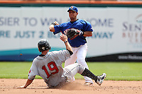 Buffalo Bisons second baseman Luis Hernandez #1 turns a double play as Chase d'Arnaud slides in during a game against the Indianapolis Indians at Coca-Cola Field on June 9, 2011 in Buffalo, New York.  Buffalo defeated Indianapolis 15-2.  Photo By Mike Janes/Four Seam Images
