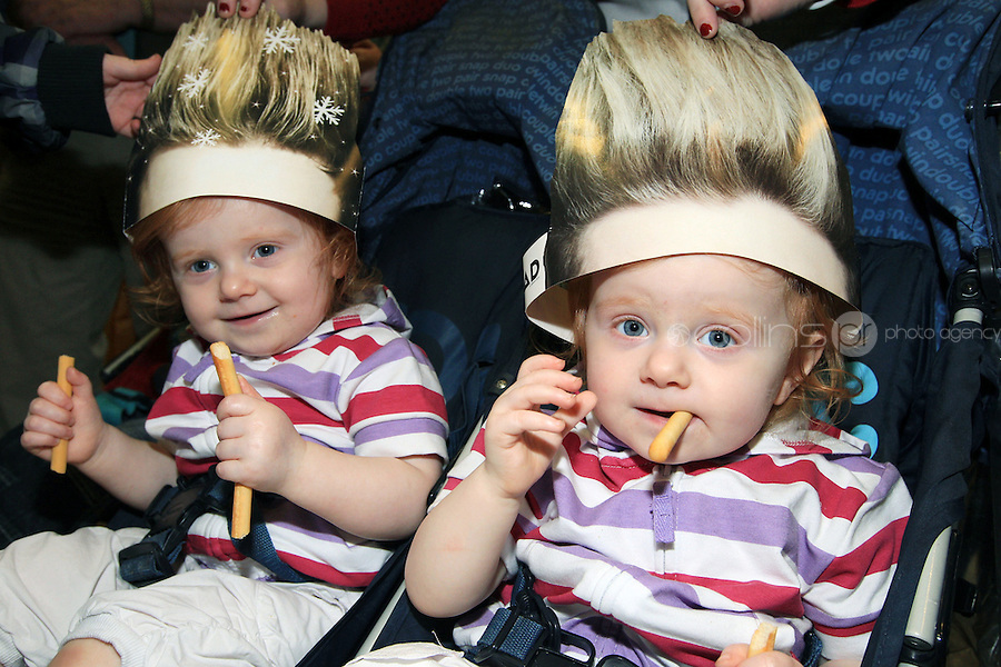 15/5/11 Fans Twins Niamh and Sinead Carolan, 2o months, Dublin wait for Jedward to arrive home at T2 Dublin Airport after finishing in 8th place at the Eurovision Song Contest in Dusseldorf, Germany. Picture:Arthur Carron/Collins