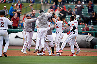 Rochester Red Wings Luis Arraez (9) celebrates a walk off single with Tomas Telis, Jake Reed, Brent Rooker (19), Jordany Valdespin, Wilin Rosario (20), and Nick Gordon (1) during an International League game against the Charlotte Knights on June 16, 2019 at Frontier Field in Rochester, New York.  Rochester defeated Charlotte 3-2 in the second game of a doubleheader.  (Mike Janes/Four Seam Images)