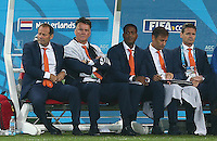 Netherlands manager Louis Van Gaal shows a look of dejection as he sits in the dugout with a towel over him to dry off
