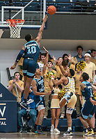 WASHINGTON, DC - FEBRUARY 8: Cyril Langevine #10 of Rhode Island goes high to block a shot by Jameer Nelson Jr. #12 of George Washington during a game between Rhode Island and George Washington at Charles E Smith Center on February 8, 2020 in Washington, DC.