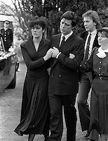 Pix: Copyright Anglia Press Agency/Archived via SWpix.com. The Bamber Killings. August 1985. Murders of Neville and June Bamber, daughter Sheila Caffell and her twin boys. Jeremy Bamber convicted of killings serving life...copyright photograph>>Anglia Press Agency>>07811 267 706>>..Jeremy Bamber is comforted by his girlfriend Julie Mugford at funeral, with Colin Caffell, father and husband of victims, alongside. no date..ref 0006 neg 31...