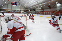 Mc Gill University Female hockey team (red and white) at a  game.<br /> <br /> <br /> Photo : (c)  2006, Images Distribution