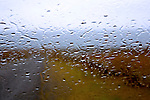 April rain coats the windshield at South Beach, a long and lovely sand and gravel beach within American Camp National Historic Park on San Juan Island.  Washington State.