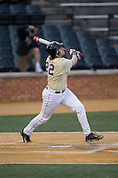 Will Craig (22) of the Wake Forest Demon Deacons follows through on his swing against the UConn Huskies at Wake Forest Baseball Park on March 17, 2015 in Winston-Salem, North Carolina.  The Demon Deacons defeated the Huskies 6-2.  (Brian Westerholt/Four Seam Images)
