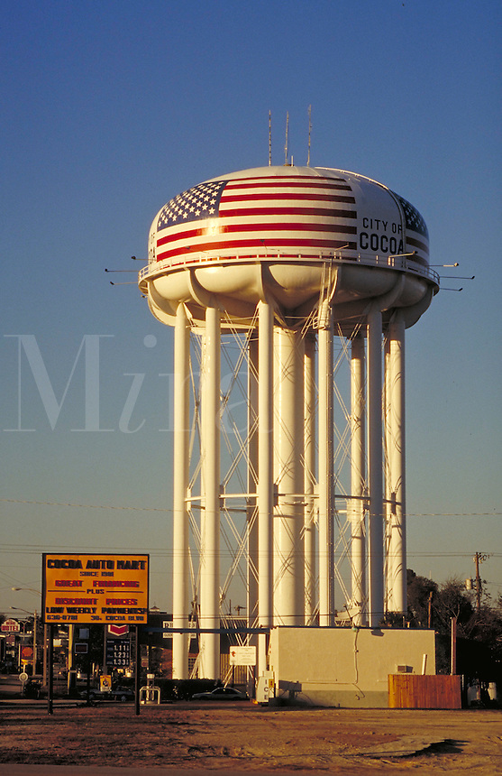 A water tower with a huge, painted American flag. urban structures, storage, functional architecture. Cocoa Florida.