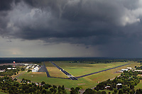aerial photograph of Mineral Wells Regional Airport (MWL), Parker County, Texasduring a passing storm