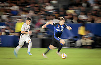 CARSON, CA - SEPTEMBER 21: Lassi Lappalainen #21of the Montreal Impact moves with the ball during a game between Montreal Impact and Los Angeles Galaxy at Dignity Health Sports Park on September 21, 2019 in Carson, California.