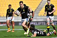 Wes Goosen of Wellington is tackled during the Bunnings NPC - Wellington v Hawke's Bay at Sky Stadium, Wellington, New Zealand on Sunday 26 September 2021.<br /> Photo by Masanori Udagawa. <br /> www.photowellington.photoshelter.com