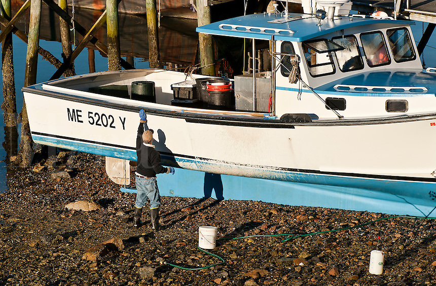 Fisherman maintaining his boat, Southwest Harbor, Maine, ME, USA